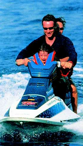 Eddie Irvine on a Jet Ski with girl screaming