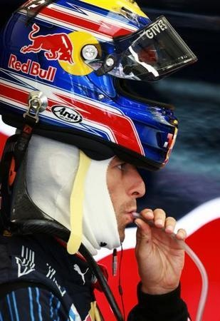 Mark Webber finds a good use for his HANS device.
